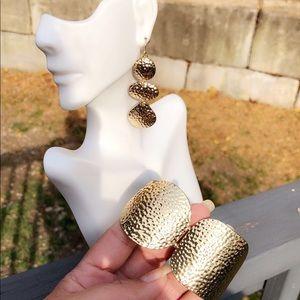 Set of gold earrings and bracelets